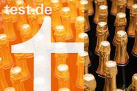 Collage Logo Stiftung Warentest und Champagnerflaschen